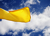 Yellow flag on beach (information about sea conditions)