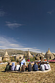 Peru, Lake Titicaca, floating islands of the Uros people, guide lecturing to tourists
