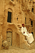 Tunisia, Tataouine, Ksar Ouled Soultane, fortified granary, Tunisian caretaker of old site
