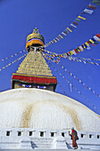 Nepal, Kathmandu, the Bodhnath Stupa, Tibetan Buddhist with prayer wheel