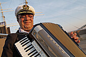 accordeon player at St.-Pauli-Landungsbrücken, port of Hamburg, Germany, Europe