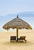 Vietnam Nha Trang Beach near the sailing club with parasol