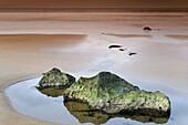 Beach with a tide pool, Berria beach, Cantabria, Spain