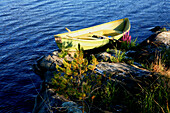 Rowing boat at the shore of an uninhabited island, Saimaa Lake District, Finland, Europe
