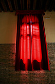 Red curtain in public building, Venice, Italy, Europe