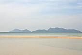 Beach on uninhabited island under clouded sky, Mergui Archipelago, Andaman Sea, Myanmar, Burma, Asia