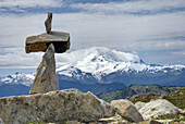 Rock cairn on the slopes of Tomyhoi Mountain Mount Baker Wilderness Washington, Mount Baker 3286 meters 10781 feet is in the distance