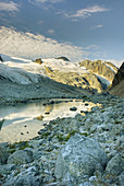Glaciated Peaks of Boulder/Salal Divide reflected in waters of a terminal glacial lake near Athelney Pass, Coast Range British Columbia Canada