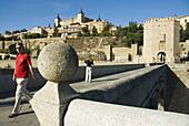 Alcantara bridge and Alcazar, Toledo. Castilla-La Mancha, Spain