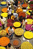 India. Bengaluru (Bangalore). City Market. Flowers necklace sellers