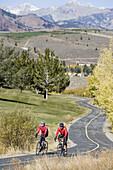 Couple road biking, Sun Valley, Idaho, USA