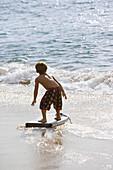Boy boogie boarding, Maui, Hawaii, USA