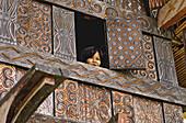 Woman at window. Tana Toraja land, Sulawesi, Indonesia