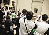 Mona Lisa (aka La Gioconda) in the Louvre Museum, Paris. France