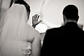 Adult, Adults, Arms raised, b&w, back view, black-and-white, Bridal couple, Bride, Bridegroom, Bridegrooms, Brides, Ceremonies, Ceremony, Contemporary, Dress, Dresses, female, Gesture, Gestures, Gesturing, Groom, Grooms, hand, hands, human, indoor, indoor