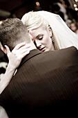 Adult, Adults, Affection, back view, Blonde, Blondes, Bond, Bonding, Bonds, Bridal couple, Bride, Bridegroom, Bridegrooms, Brides, Caucasian, Caucasians, Closed eyes, Color, Colour, Contemporary, couple, couples, Dance, Dancing, Dress, Dressed up, Dresses