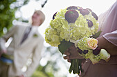 Adult, Adults, Bouquet, Bouquets, Ceremonies, Ceremony, Color, Colour, Contemporary, Daytime, detail, details, Dressed up, Elegance, Elegant, exterior, female, flower, flowers, hand, hands, Hold, Holding, human, male, man, marriage, matrimony, men, outdoo