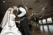 Adult, Adults, Bridal couple, Bride, Bridegroom, Bridegrooms, Brides, Caucasian, Caucasians, Celebrate, Celebrating, Celebration, Celebrations, Closed eyes, Color, Colour, Contemporary, couple, couples, Daytime, Dress, Dressed up, Dresses, Elegance, Elega