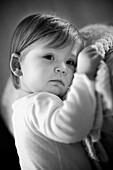 b&w, black-and-white, Blanket, Blankets, Brunette, Brunettes, Caucasian, Caucasians, Child, childhood, Children, Contemporary, Dark-haired, Facing camera, Female, Girl, Girls, human, indoor, indoors, infancy, Infant, Infants, Innocence, Innocent, interior