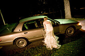 Adult, Adults, Auto, Automobile, Automobiles, Autos, back view, blurred, bride, brides, Car, Cars, Color, Colour, Contemporary, Dress, Dresses, Escape, Escaping, exterior, female, Full body, Full length, Full-body, Full-length, Get away, Get-away, Get-awa