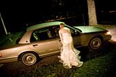 Adult, Adults, Auto, Automobile, Automobiles, Autos, back view, blurred, bride, brides, Car, Cars, Color, Colour, Contemporary, Dress, Dresses, Escape, Escaping, exterior, female, Full body, Full length, Full-body, Full-length, Get away, Get-away, Get-awa