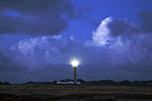 Brittany, Belle-Ile: large lighthouse  under the cloudy sky