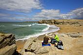 Bretagne, Quiberon: contemplation, sitting on a rock facing the sea