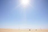 Cars travelling through the desert, coastal desert south of Swakopmund, Namibia, Africa