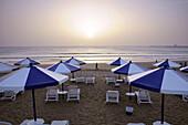 Sunshades on the beach at sunset, Agadir, South Morocco, Morocco, Africa