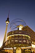 Alexanderplatz world clock TV tower at night in Berlin
