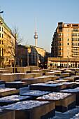 Berlin Holocaust Memorial in winter , Beton stelen by architect Peter Eisenmann