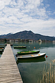 Wooden jetty at lake Tegernsee, view towards Rottach-Egern, Upper Bavaria, Bavaria, Germany