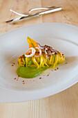 Pasta, tagliolini with zucchini blossoms and baby calamari, restaurant Trenkerstube, Hotel Castel, Dorf Tirol near Meran, South Tyrol, Italy