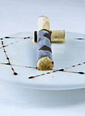 Dessert chocolate cigar with Libanese cedarwood flavoured ice cream, tabacco and rum in restaurant Anna Stuben, chef Armin Mairhofer, Hotel Groednerhof, St. Ulrich, South Tyrol, Italy