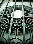Air-conditioner, Air-conditioning, bar, bars, Close up, Close-up, Closeup, Color, Colour, Concept, Concepts, Cooling fan, Cooling fans, Daytime, detail, details, Equipment, exterior, Fan, Fans, Gear, Industrial, Industry, Metal, outdoor, outdoors, outside