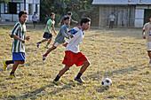 Myanmar  Catholic semonarians playing football, Myitkyina, a largely Kachin community in north Burma near the Chinese border