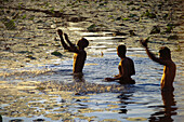 Men bathing, Sri Lanka