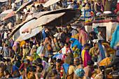 Pilgrims bathing in holy river Ganges