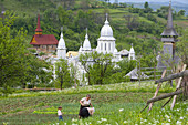 Churches of Botiza & working in vegetable patch, Maramures, Romania