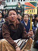 free sign on a prayer wheel at Tibetan protest rally against Chinese