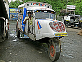 A man driver is travelling Mad max local transports vehicle along the road  Mhow, Madhyaprsdesh, India
