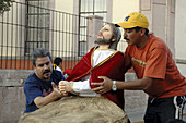 Preparing a float (Jesus praying in the garden of Gethsemane) for the Procession of Silence on Good Friday. Zacatecas. Mexico.