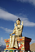 The Buddha Maitreya is the Buddha of the future Its body is filled with rolls of religious buddhist praying text
