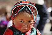 Tibetan little girl in Thangka festival