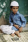Panjim Goa, India, Muslim boy during the Jashn-Eid-Milad Un Nabi feast, commemorating prophet Mohammeds birth
