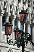 Venice Italy, pigeons on a street-lamp in front of Palazzo Ducale
