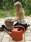 Young girl doing gardening.