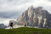 Hikers in the Five Torri, Dolomites, Italian Alps. Italy. Europe.