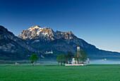 St. Coloman church in morning mist, near Schwangau, Allgaeu, Bavaria, Germany