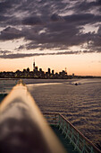 Railing of cruiseship MV Columbus and skyline at sunset, Auckland, North Island, New Zealand, Oceania